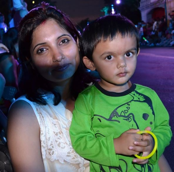 A younger Abhi with his mother