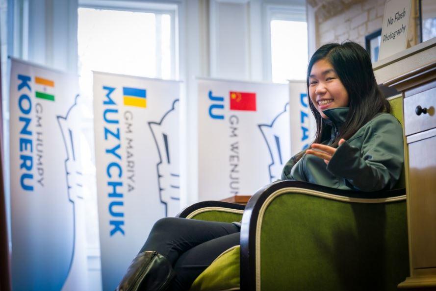 Carissa smiling sitting chair after defeating World Champion Ju Wenjun