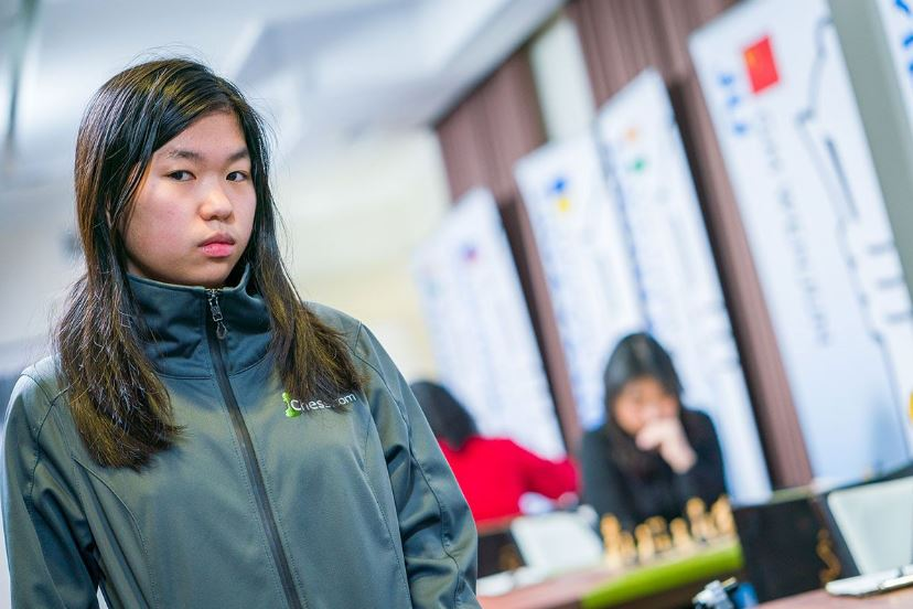 Carissa standing with Wenjun in background defeats World Champion Ju Wenjun