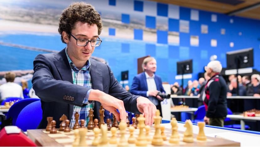 Fabiano Caruana sitting at chessboard #2 in World March 2020