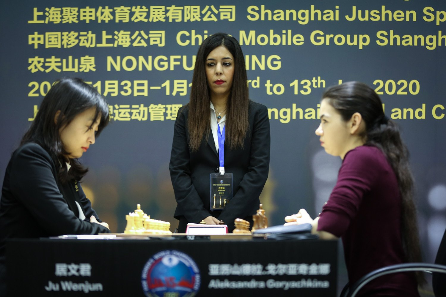 Game 6 starting position players at chessboard at the Women's World Chess Championship