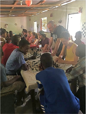 Playing chess with kids from LovingHaiti.org orphanage