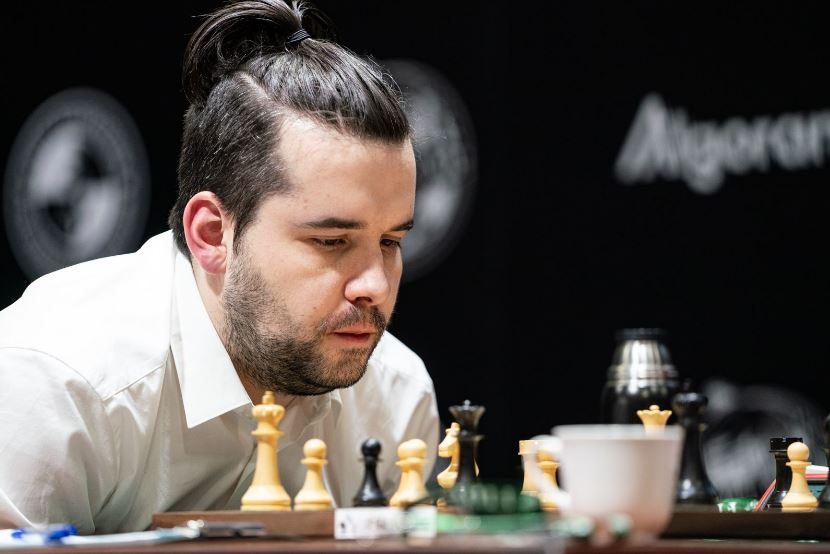 Ian Neopmniachtchi Round 6 with man bun looking over the chessboard at 2020 World Chess Candidates Tournament
