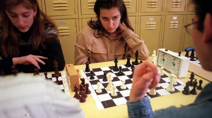 Irena Krush 15 years old at chessboard in high school chess club