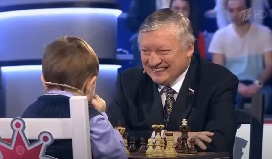 Karpov smiles as he plays Misha Osipov 3 years old.