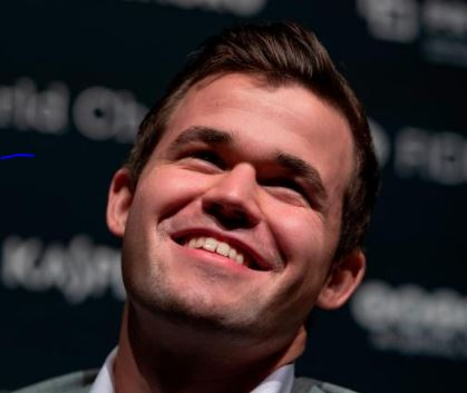 Magnus Carlsen  smiling big.