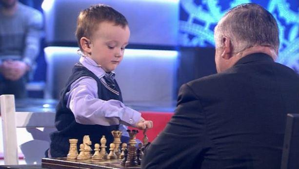 Misha Osipov 3 years touching white Bishop during game with Anatoly Karpov.