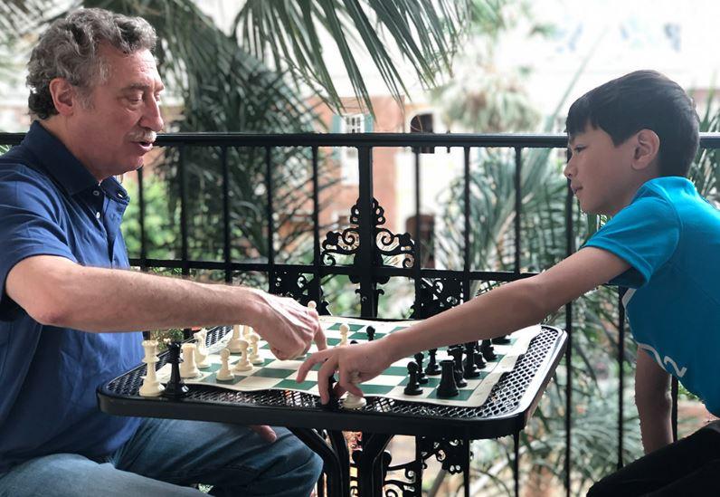Oliver with his chess teacher Bruce Pandolfini