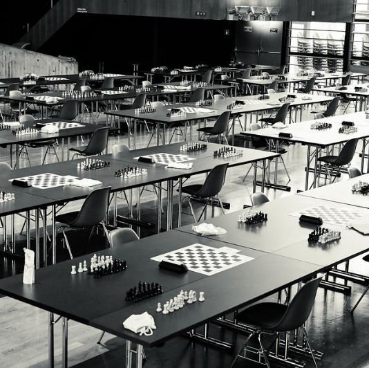Open Section of chess tournament hall set up with masks, sanitizer provided, no plexiglass shields