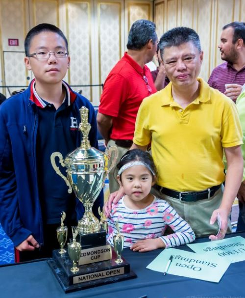 RachaeRachael Li with brother and father in 2016.l Li in USA Chess Women cap with coffee cup to mouth.