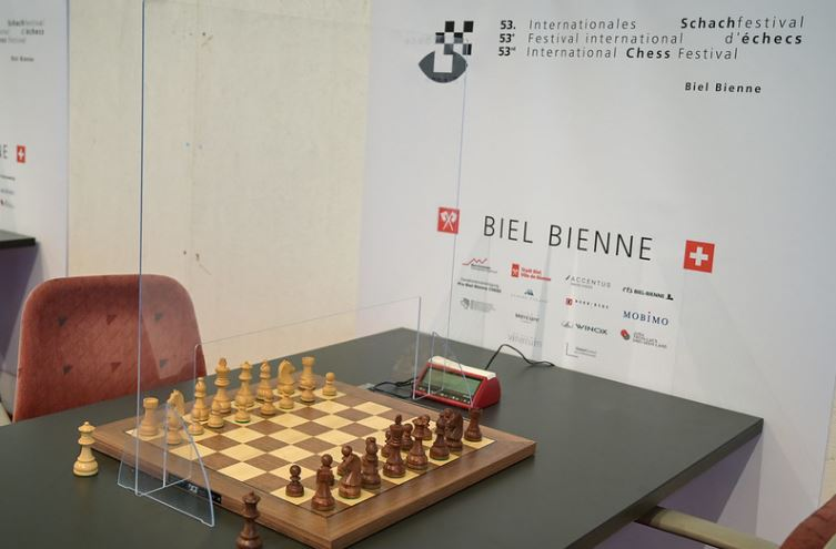 chess board on table with plexiglass shield set up